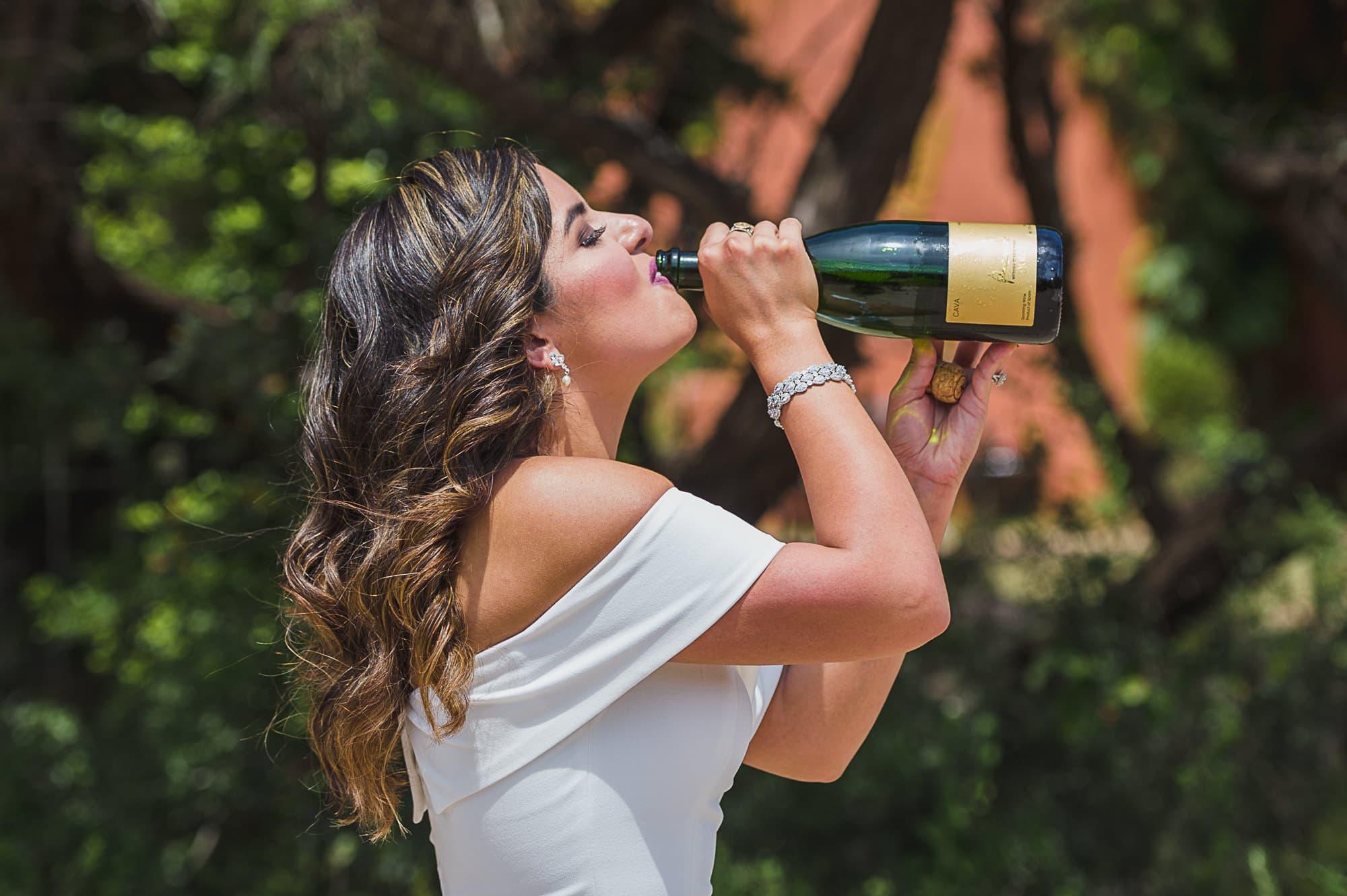 bride-drinking-from-champagne-bottle-at-chapel-dulcinea-in-austin-texas-san-antonio-wedding-photographers-_4S10508